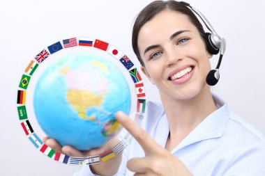 Customer service operator woman with headset smiling, holding globe