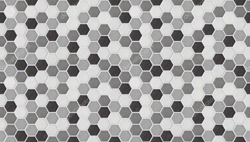 Piccole mattonelle esagonali senza soluzione di continuità di