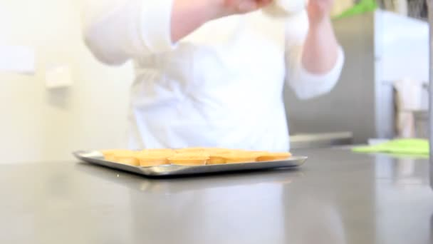 Hands stuffing pastry cream sweets