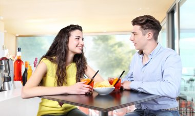 Young couple meet at the bar for drink a cocktail