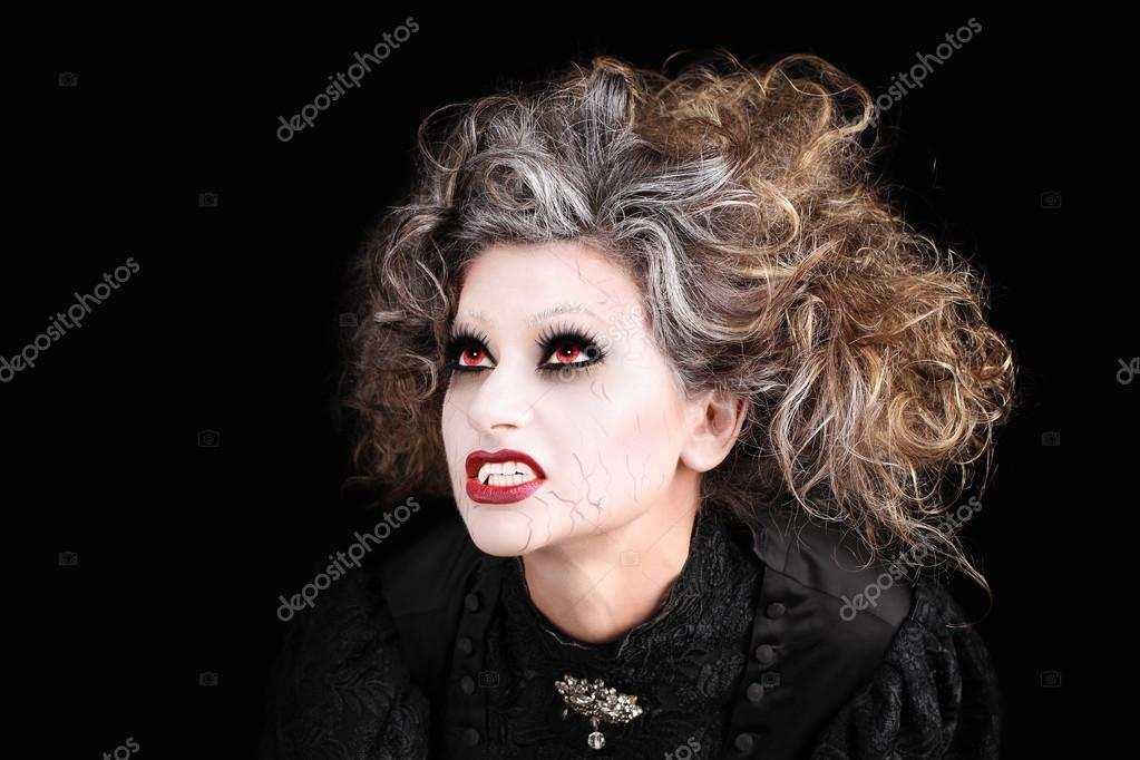 vampire woman portrait with mouth open showing teeth canines, ha