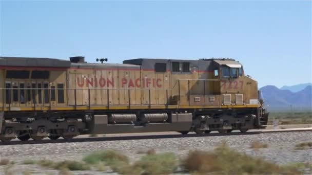 Locomotive moving long freight container train