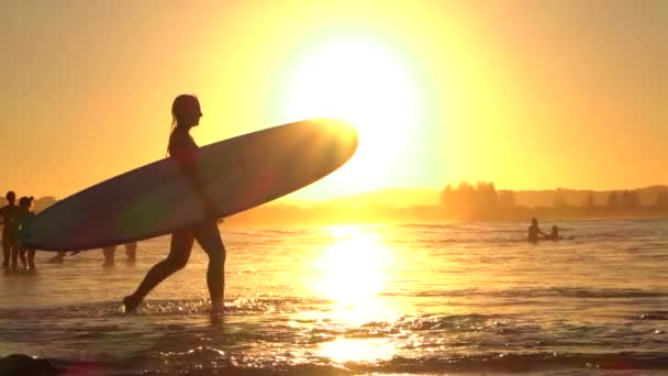 Slow Motion Young Surfer Girl Going Surfing Into Ocean With