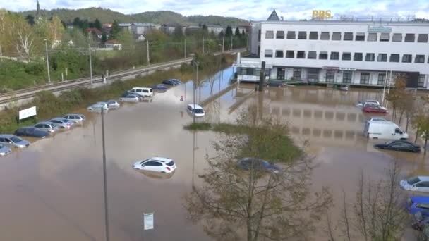 Cars stuck in flooded parking