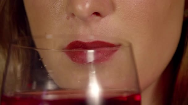 Woman with red lips drinking wine