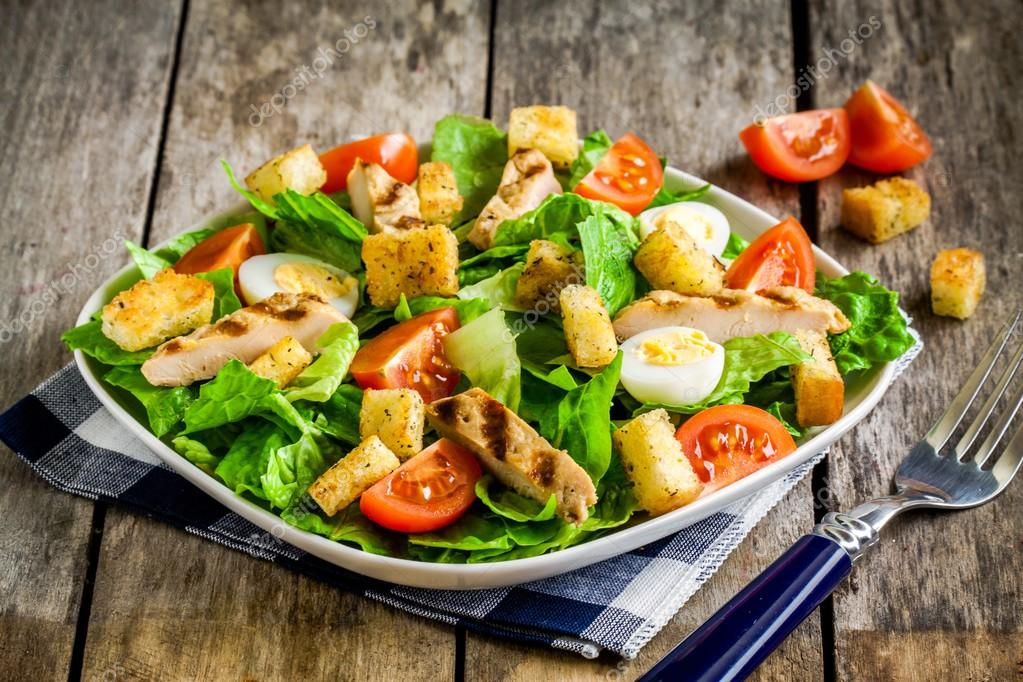 Caesar salad with grilled chicken, croutons, quail eggs and cherry tomatoes