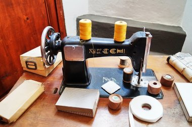 Sewing machine in the old tailoring of  Pia Casa Montedomini Florence Italy