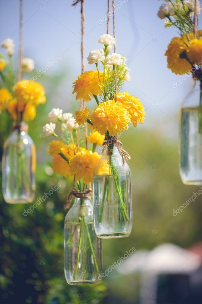 The Marigold Flowers In A Gl Bottle Hanging Flower Vase Arrangements Vintage Tone Colour Photo By Sirastockid08