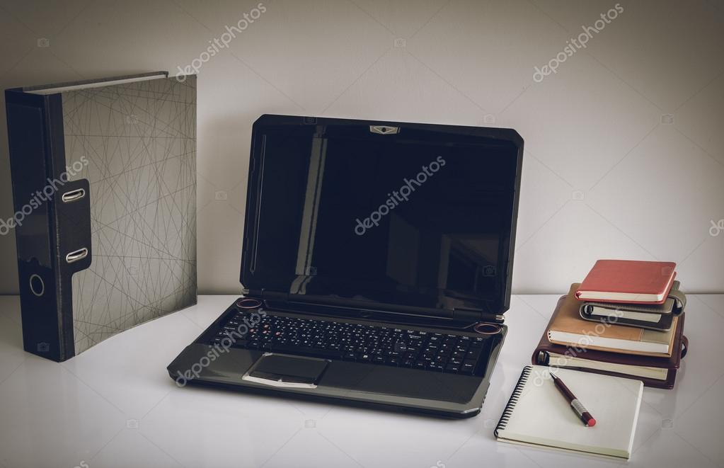 laptop computer on top of office table of a businessman stock rh depositphotos com Office Stationary Table People around Table Office