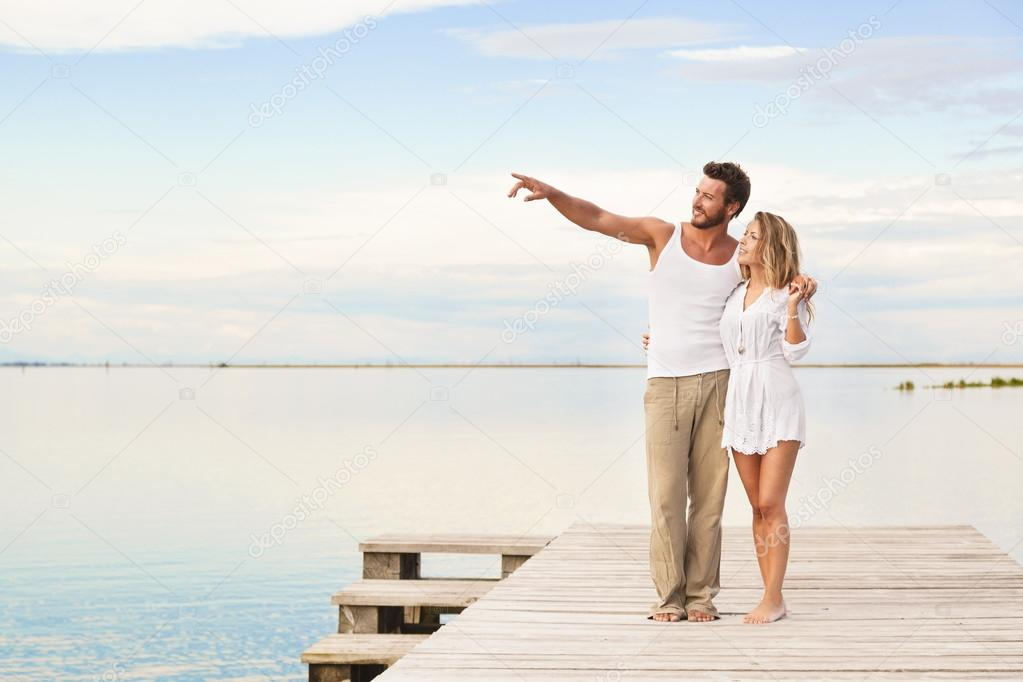Couple walking and pointing to the horizon