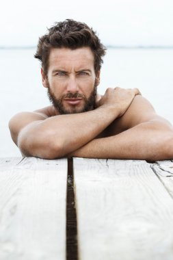 Sexy Handsome Man with beard and No Shirt at the Sea