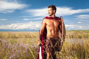 Fighting ancient warrior in landscape background