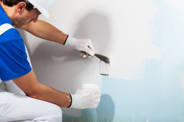 Workman Applying Plaster with Putty Knife