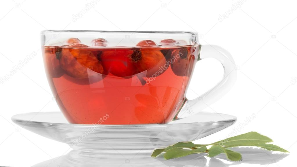 Transparent cup with tea and rose hips isolated on white