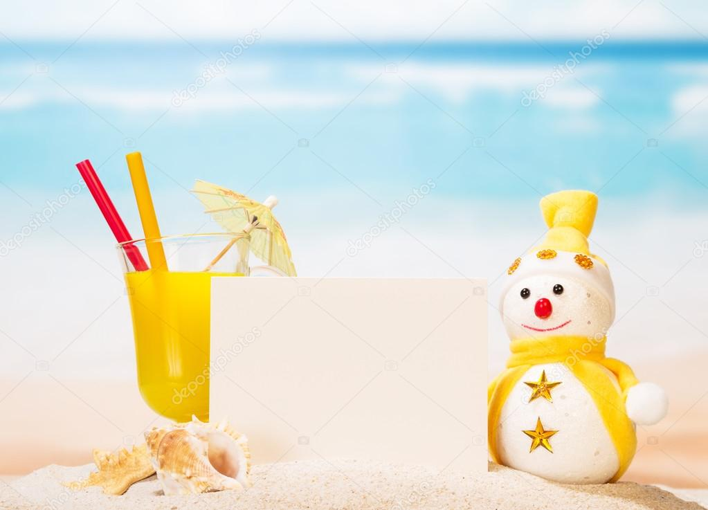 Blank card, cocktail, snowman, sea shells and  star in sand .