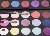 Fotografie Eyeshadow palette cosmetic brushes and makeup. Background.