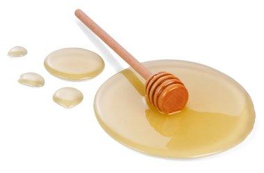 Honey on wooden dipper