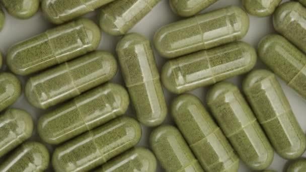 superfoods moringa capsules top view. Spirulina, chlorella capsules