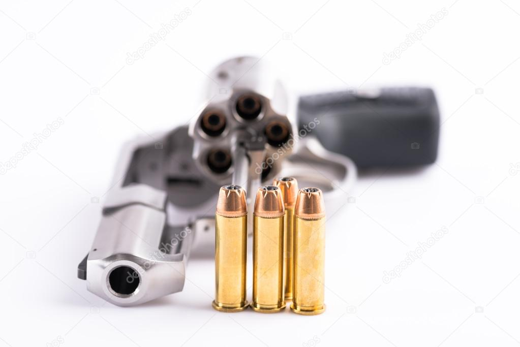 Macro shot of an open revolver and bullets — Stock Photo © tumeyes