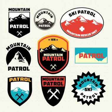 Set of ski patrol mountain badges