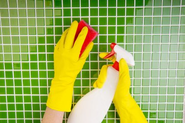 washing the tiles in the bathroom