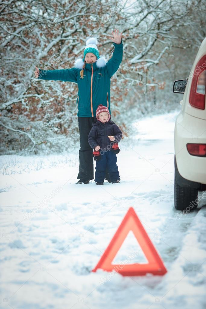 woman with a child on the winter road.