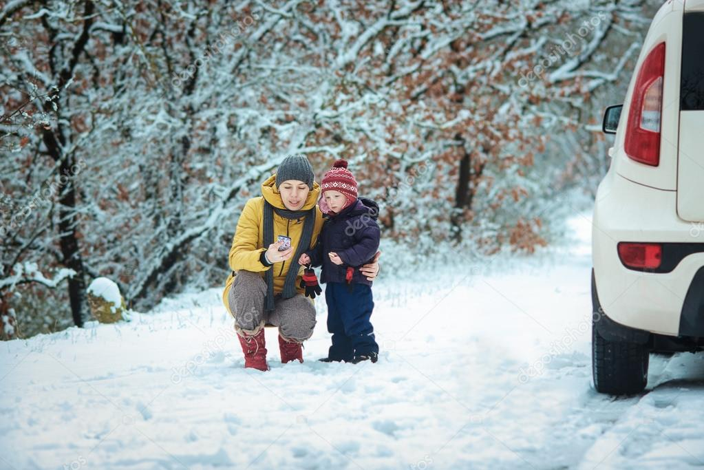 woman with a child on the winter road
