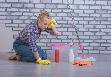 Girl washes the floors