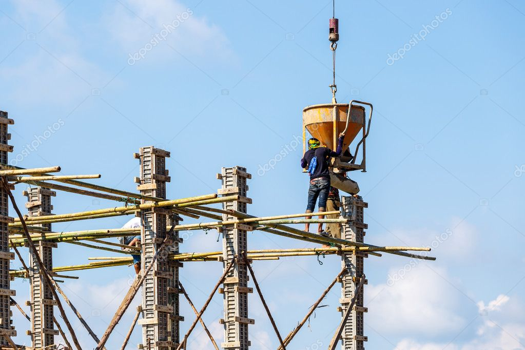 Worker working in construction on blue sky