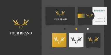 Deer head logo design with antlers forming wings in elegant gold color icon
