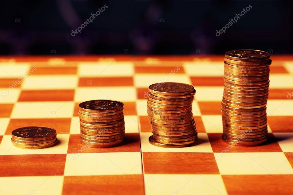 Coins On A Chessboard Finance Concept Money Concept Stock Photo