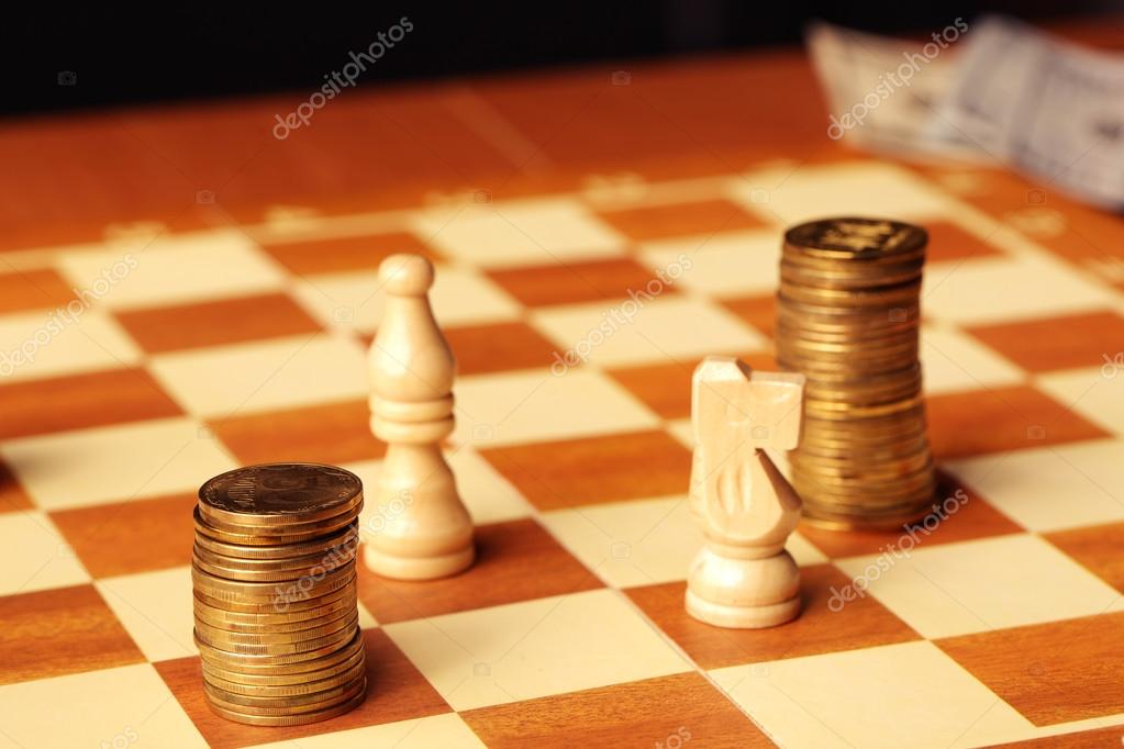 Gold Coins Stacked Like A Pawn On A Chess Board Stock Photo
