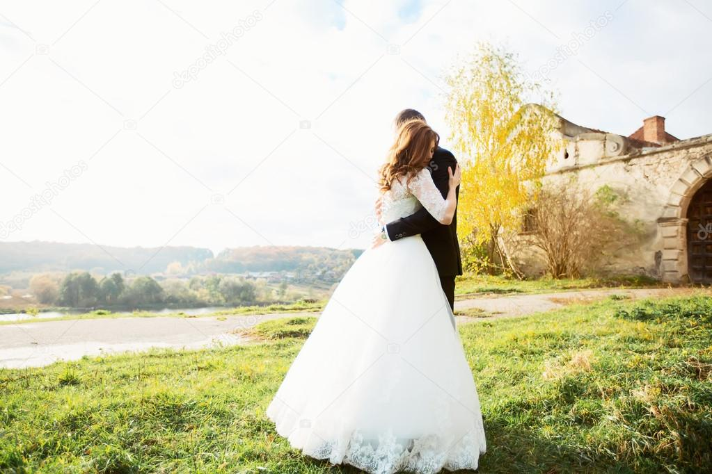 Portrait Of A Girl And Couples Looking For A Wedding Dress A Pink