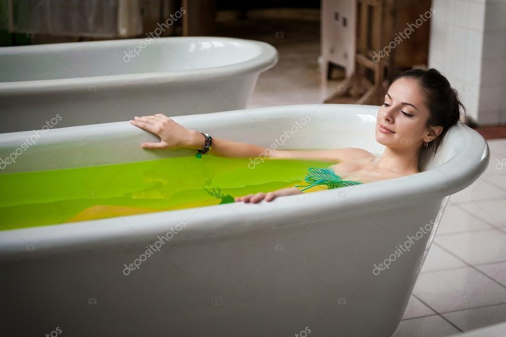 Woman in a bathtub with green water — Stock Photo © savitskiy.lev ...