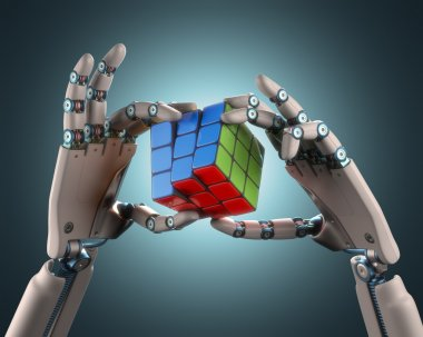 Robotic hands holding a colorful cube