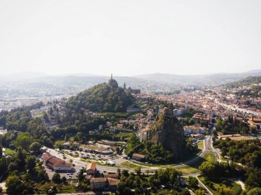 Aerial panorama of historic architecture town Le Puy-en-Velay church on hill Haute Loire Auvergne Rhone Alpes France