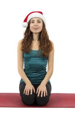 Christmas woman doing hero pose in yoga