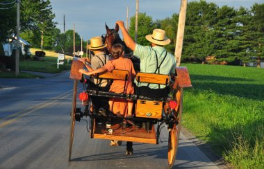 Lancaster County, PA: Amish Family Riding in Buggy