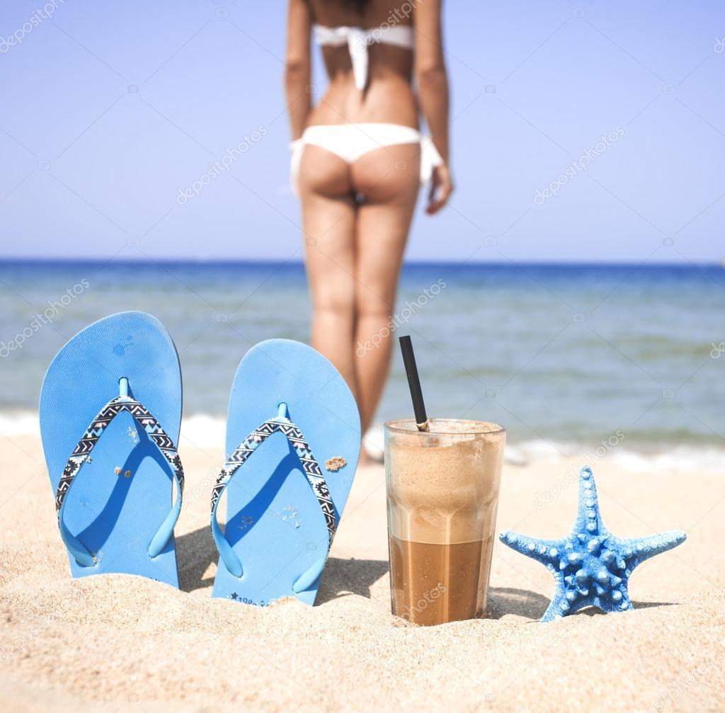 Iced coffee on a sandy beach