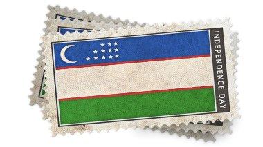 uzbekistan  flag on stamp independence day is overlay