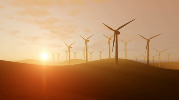 Rotující větrné turbíny při západu slunce