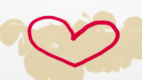 Hand drawn red heart on beige background