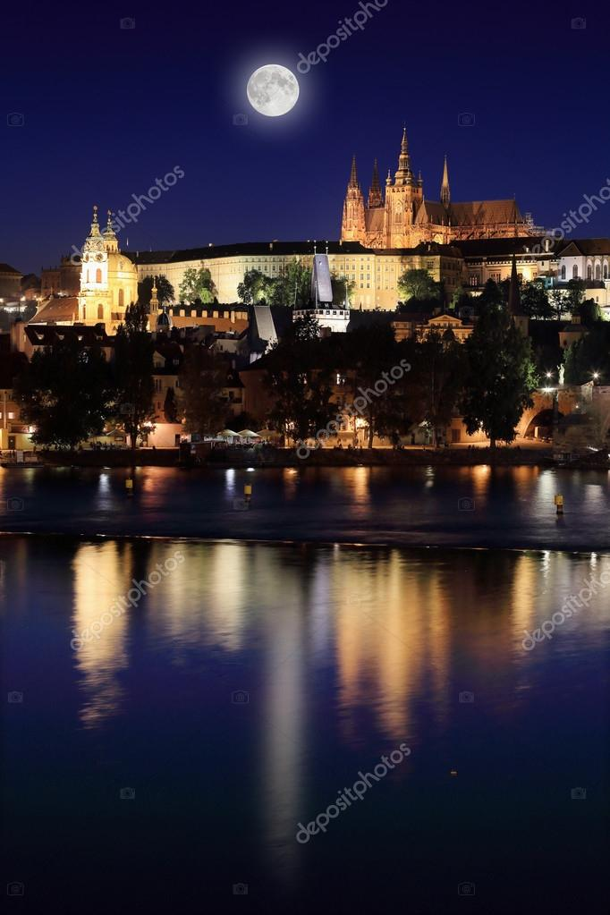 Night Prague Gothic Castle Above River Vltava With The Moon Czech Republic Stock Photo