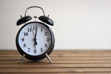 Vintage alarm clock on wooden table