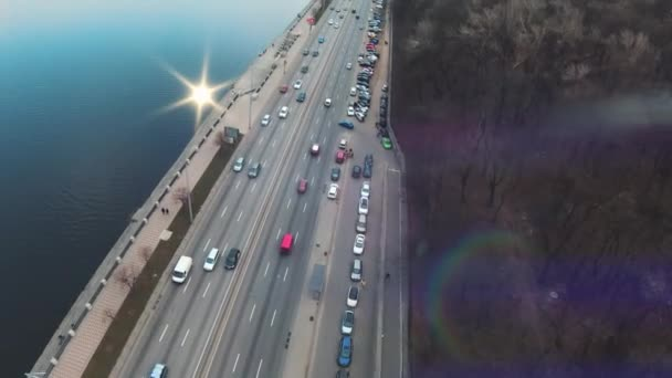 Aeria view road with driving cars near river. Drone, cars trucks, forest, tourist, water, urban, infrastructure, city, architecture, aerial, copter, travel. Slow motion