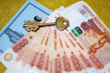Russian money, savings book and the key