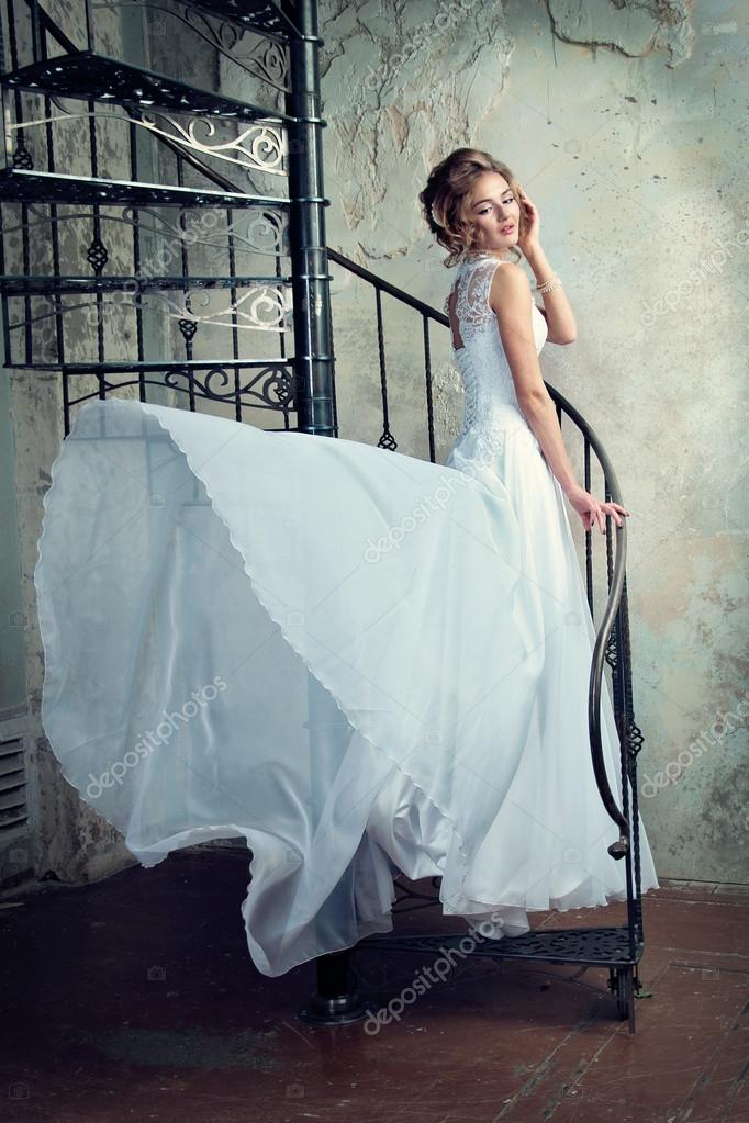 beautiful young girl in a wedding dress — Stock Photo © nelyninell ...