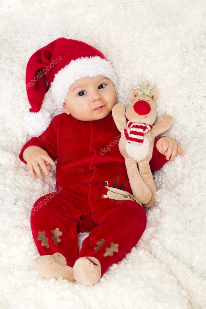 7dfb459d9 Little cute baby boy, dressed in red overall with santa hat — Stock ...