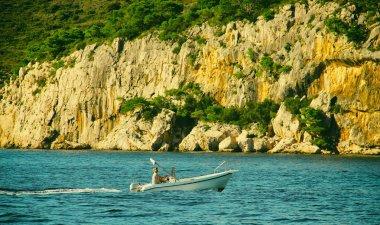 Man is Sailin on Boat