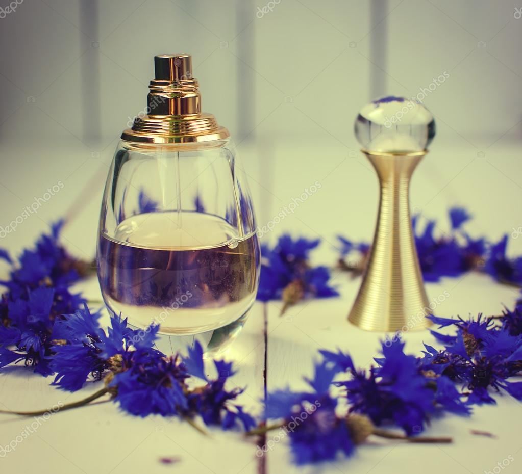 Female perfume with blue flowers stock photo martyna1802 115877668 female perfume with blue flowers stock photo izmirmasajfo